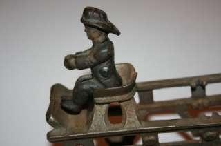 Up for sale is an Genuine old cast iron ladder fire wagon. I do not