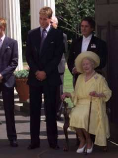 Prince William bends down to talk to The Queen Mother outside Clarence